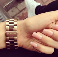 Gold watch and pink nude nails