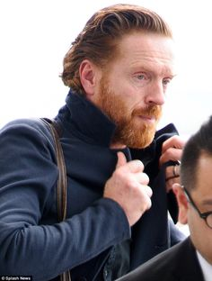 Beardy babe: Damian wore his new long hair slicked back off his face, exposing his stylish...