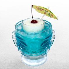 """Blend the """"land"""" ingredients together and pour into a tall collins glass. Place collins glass inside fishbowl or pitcher filled with ice. Pour in """"sea"""" Fun Drinks Alcohol, Liquor Drinks, Yummy Drinks, Alcoholic Drinks, Beverages, Summer Cocktails, Cocktail Drinks, Coconut Rum Drinks, Party On Garth"""