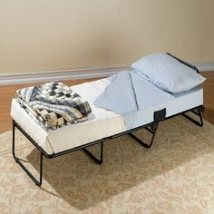 This RV ottoman doesn't look like a traditional pull out bed. It has a steel frame that holds a memory foam mattress that's 24.5″ x 29″ x 18″H closed and ...