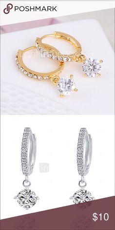 Silver hoop earrings w Swarovski crystals Beautiful silver plated little hoop earrings with dangling Swarovski crystals, hoop embellished with little stones adopt Jewelry Earrings