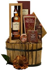 The Epitome of Luxury gift basket: a rustic wood container filled with assorted snacks, cookies, chocolate and The Glenlivet 21 Year Old, $315.00