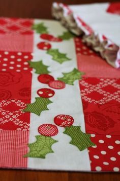 Holly and Patchwork Runner/Placemat. I would love this on my table during the Holidays. Christmas Sewing, Christmas Projects, Holiday Crafts, Christmas Quilting, Christmas Runner, Christmas Patterns, Christmas Tea, Table Runner And Placemats, Quilted Table Runners