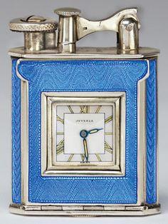 Blue hard glass enamel and silver watch lighter, late 1920s, by JUVENIA in Switzerland. David Golden. (hva)