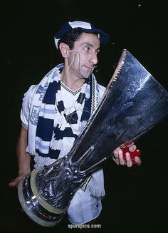 Tottenham Hotspur's Osvaldo Ardiles carrying the UEFA Cup after Spurs had beaten Anderlecht 4-3 on penalties in the UEFA Cup Final 2nd leg at White Hart Lane, 23rd May 1984. (Photo by Bob Thomas/Getty Images)