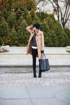 Black pants, grey sweater, camel coat