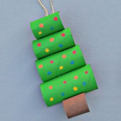 Toilet Paper Roll Christmas Tree Craft is part of Easy Upcycled Crafts Toilet Paper Rolls - Turn your recycled toilet paper rolls into a fun and creative Christmas tree craft Christmas Tree Crafts, Preschool Christmas, Christmas Activities, Simple Christmas, Holiday Crafts, Christmas Ornaments, Kids Christmas, Christmas Decorations For Classroom, Elegant Christmas