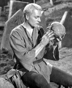 "This picture represents a very famous and important scene in the play. Hamlet comes to realization that we are all equal in death. Hamlet is deeply disturbed when he realizes that the skull once belonged to Yorick, the old king;s jester. He says "" This skull had a tounge in it and could sing"" (243). This quote says that after death, nothing matters anymore."