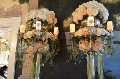 silver candle auras available for rent. Gorgeous floral atop