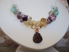 This one-of-a-kind, HANDMADE sterling silver and gemstone necklace is show stopping! Top quality gemstones, strung with sterling silver. ALL metal is .925 sterling silver.  Stones include:  smokey quartz, citrine, lemon topaz, lemon quartz, green amethyst, iolite, pink topaz, pink quartz, pink amethyst, purple amethyst, peridot,blue mystic quartz, aquamarine, apatite, amazonite, aqual chalcedony, rainbow moonstone. and mexican fire opal.