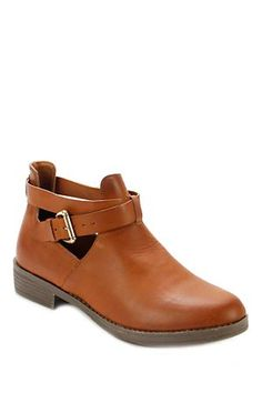 Ankle boot. Cut out detail. Buckle side closure. Closed back. Closed round toe.<BR><BR>Shoe Upper:<BR>PU Upper<BR><BR>Shoe Sole:<BR>Plastic Sole<BR><BR>Wash Care:<BR>Do not wash