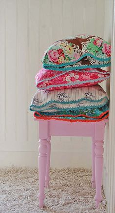 ...lovely fabrics on pink stool!