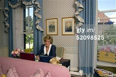October 6, 1985: Princess Diana at her desk in her sitting room at home in Kensington Palace, London. On the table is her school tuckbox with the name D. Spencer. (Photo by Tim Graham/Getty Images)