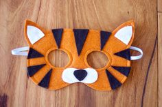 Beautiful handmade soft felt Tiger mask. Perfect for dress-ups and inspiring imaginative play.  Masks are crafted, cut and lovingly embellished by hand. All masks are made from at least 2 layers of highest quality Merino wool felt for comfort and durability and elastic is double stitched to withstand even the most enthusiastic of play!  Age 3+  Gift wrapping is available, please select it as a separate item from my shop to add to your order.  * colours may vary slightly  Masks should be hand…