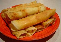 Wellawahum (Sri Lankan Pancakes with coconut): Sri Lanka Recipes : Malini's Kitchen. So good.
