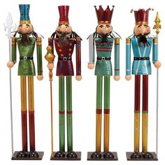 Whimsical Nutcracker Set - these would look nice displayed on a mantel with Christmas greenery and lights. I like how they are tall and skinny.
