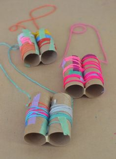 kids make this simple binocular craft with yarn and colored tape More