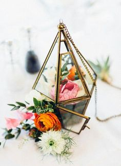 Terrarium with flowers as centerpieces