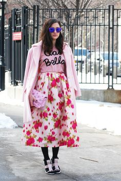 Another pink coat at NYFW, this time paired with a graphic tee and floral midi skirt on Eleonora Carisi.