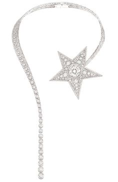 Chanel-Collier-Comete-The star of the show is the Comète necklace that swoops around the neck and displays an impressive 15 carat white diamond set into the heart of the shooting star