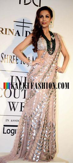 Malaika Arora Khan in chiffon sarees for Rina Dhaka at Indian Couture Week 2014. http://www.kalkifashion.com/