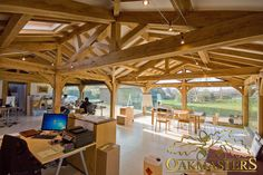 King post oak trusses with rafters enhancing this sun room.