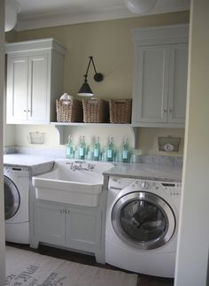 love this laundry room.   Clean in all white and my favorite sink!!!!!!  Love it.   A girl can dream about laundry rooms?  Heck, yes!!!!  I dream about every room from the kitchen, to my outdoor bath, to sunny bedrooms, and let us not forget my enormous his and hers closet.  More so....I am {dreaming about when the HIS is coming into my life as well}.  Have the space for this too:)
