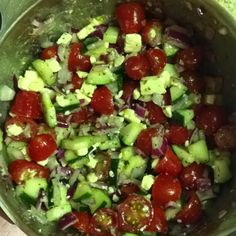 My Fav Greek Salad.  Cucumber, tomatoes, red onion, feta, and greek salad dressing. YUMM!!! Even better the next day!