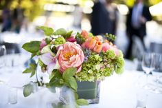 Lots of beautiful, low table arrangements at this wedding!