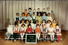 Michelle Obama's kindergarten class picture. Michelle Obama stands on the third row (second from the right) and her first kiss, Dr. Theodore Ford, stands on the back row (second from the left).