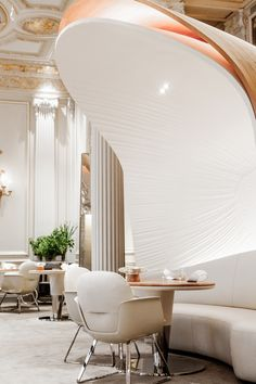 Travel // Plaza Athénée By Jouin Manku. As you enter the restaurant, your attention is drawn to the monumental polished stainless-steel domes on the floor that reflect the thousands of floating crystals of the ceiling chandelier, the only retained element of the restaurant's former design. These super-scaled and unusual domed shapes form the backrest of banquettes where diners can sit, or screen off groups of tables and chairs.