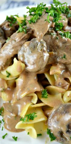 Creamy Beef Stroganoff- Quick and easy to put together. Loaded with strips of beef and mushrooms. The gravy is really wonderful- thick, rich, and creamy with a little sour cream tang!