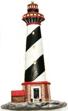 "Refrigerator Magnet.  Lighthouse:  Height: 5.5"". Width: 3.25"".  Thick: .020. Weight: 0.056oz.  Colors from a real lighthouse.  Lighthouse: White, black, red,  and silver trim. Base: Brown  white trim, black door with  red trim. Small building:  Has  brown sides with a red roof.  Stone base: Gray stones with   black accents. Unique keepsake  gift.  Hand-painted by LSC Creations.  $11.50 each."
