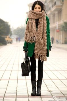 Green coat with beige muffler