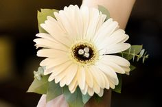 Large blush gerber daisy with bling accents, bling wristlet and greens.