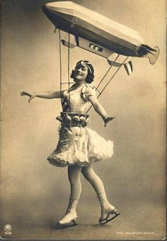 A nice lady skating with a Airship.