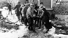 MONUMENTS MEN: Monuments Officer, Walker Hancock, left, removing an ancient religious sculpture from the ruins of La Gleize Church, Belgium, after the Battle of the Bulge. http://www.aaa.si.edu/collections/viewer/interior-la-gleize-church-belgium-after-battle-bulge-15132 for interior view