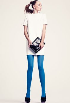 So mod. I heart the blue tights against the solid white dress