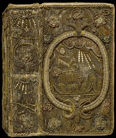 Book cover.| V&A. England, 1631  Canvas covered w satin & embroidered w silver & silver-gilt threads, strip & purl, spangles &  colored silk in raised, couched & laid work.