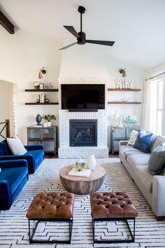Blue velvet chairs + white brick fireplace | House of Jade