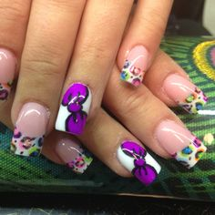 Rainbow cheetah bow nails by Celeste Young