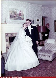 Bride and groom, 1950s. With grandma peeking out from behind the corner.