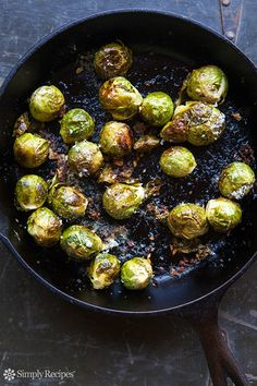 Brussels sprouts, oven-roasted with garlic, olive oil, lemon juice, salt, pepper, and Parmesan cheese. EASY and so tasty! A favorite Thanksgiving side. On SimplyRecipes.com