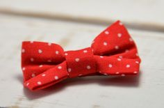 Barrette bébé clic-clac petit nœud / Rouge à petits pois blancs
