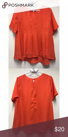 FRANCESCA'S Everly Flowy Top Size small Light orange/coral Flowy Slight hi/low Gently worn *Open to offers Francesca's Collections Tops Blouses