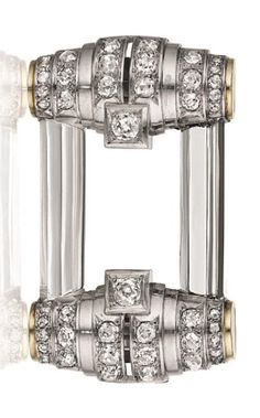RENÉ BOIVIN A Rock Crystal, Diamond and Platinum Brooch Centering on a rectangular rock crystal frame, to the bombé gold terminals, accented with old-cut diamonds, mounted in 18K white gold, length 2 3/4 inches. With French assay marks andhallmarks for René Boivin, with a letter of authenticity
