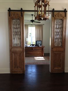 "Our antique French iron exterior doors hung ""barn door"" style and our custom desk designed from antique French doors."