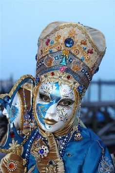 An extraordinary bejeweled costume and a beautifully detailed mask in blue and gold.