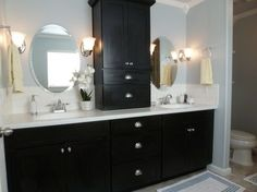 I really like the middle storage cabinet idea for our master bathroom.  Saw it over at Tell'er All About It.