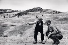 ITALY. Near Troina. August 4-5, 1943. Sicilian peasant telling an American officer which way the Germans had gone